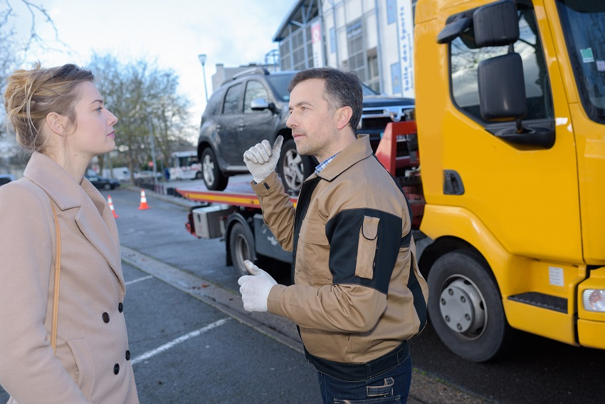 Recovery driver talking to woman