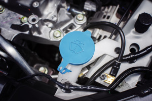 Windshield washer fluid cap with blue color in engine room of ca